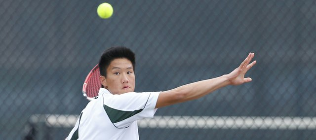 Free State senior Richard Lu winds up for a return against Lawrence High junior Thomas Irick during the No. 1 singles match, Tuesday, April 9, 2013, at Lawrence High.