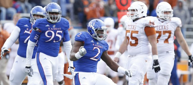Kansas defensive end Darius Willis pumps his fist after sacking Texas quarterback David Ash during the third quarter on Saturday, Oct. 27, 2012 at Memorial Stadium.