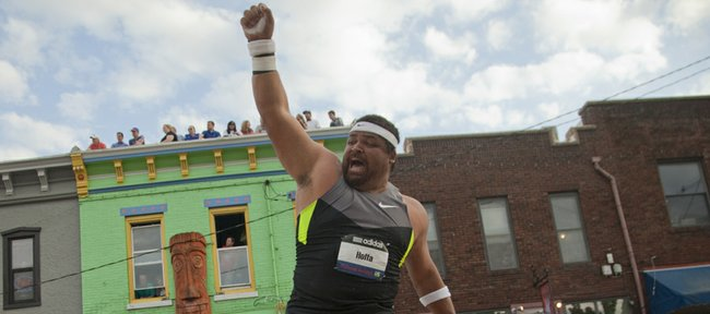 Reese Hoffa celebrates his last and longest throw of the Kansas Relays Men's Elite shot put event on Wednesday, April 18, 2012, in downtown Lawrence.