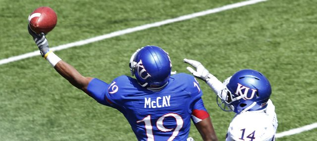 Kansas Blue team receiver Justin McCay makes a one-hand catch against the White team'ss Nasir Moore on Saturday, April 13, 2013, at the KU football spring game. The Blue team won, 34-7.