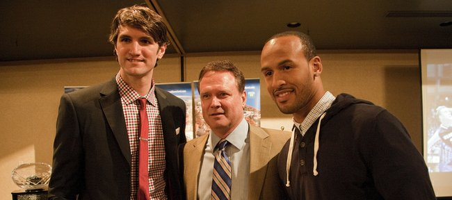 Jeff Withey, left, and Travis Releford flank Kansas basketball coach Bill Self as they were named co-winners of the Danny Manning Award at the annual KU basketball banquet Monday, April 15,2013, at the Holiday Inn.