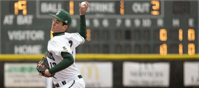 Free State senior Dane McCullough goes through his pitching motion during Free State's game against Leavenworth Monday evening at FSHS.