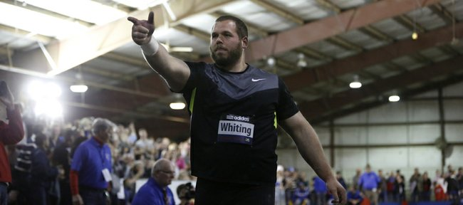 Thrower Ryan Whiting points to his tightest competition Reese Hoffa after besting Hoffa's throw to reclaim the lead during the Elite Men's Shot Put event of the 2013 Kansas Relays in the livestock arena of the Douglas County Fairgrounds. Nick Krug/Journal-World Photo