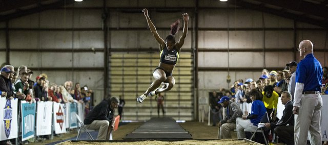 Janay DeLoach-Soukup soars through the air as the crowd watches during the Kansas Relays Women's Elite Pro long jump event, held Thursday evening at the Douglas County Fairgrounds.