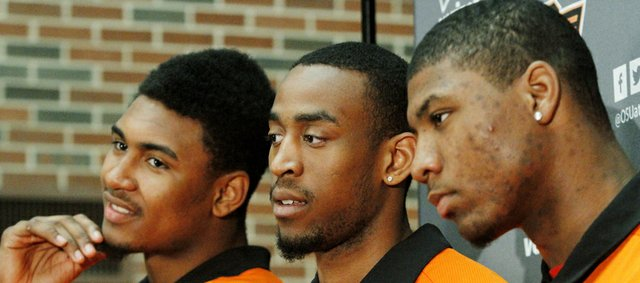 From left, Oklahoma State's Le'Bryan Nash, Markel Brown and Marcus Smart attend a news conference to announce their intention to return for another NCAA college basketball season on Wednesday, April 17, 2013, in Stillwater, Okla.