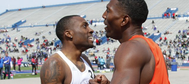 Kansas sprinter Michael Stigler, left, congratulates Michael Tinsley after Tinsley finished first in the Mens' 400 Meter Invitational Hurdles event of the Kansas Relays on Saturday, April 20, 2013 at Memorial Stadium. Stigler took second in the race. Nick Krug/Journal-World Photo