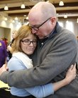 Kevin Stuever gives his wife, Susan, a hug following the Celebration of Volunteers! event at the Carnegie Building in Lawrence on Tuesday, when Susan was honored with the Wallace Galluzzi 2012 Outstanding Volunteer Award for her work with the Health Care Access Clinic.