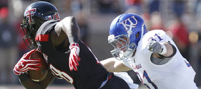 Kansas linebacker Ben Heeney chases down Texas Tech receiver Eric Ward after a catch during the first quarter on Saturday, Nov. 10, 2012 at Jones AT&T Stadium in Lubbock, Texas.