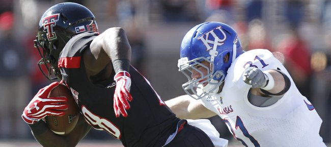Kansas linebacker Ben Heeney chases down Texas Tech receiver Eric Ward after a catch during the first quarter on Saturday