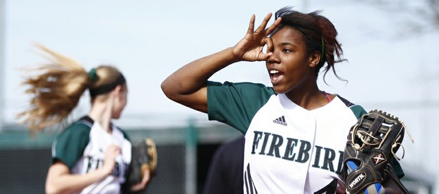 Free State shortstop A'Liyah Rogers signals three outs to the outfield after a strikeout by pitcher Meredith Morris during the third inning against Shawnee Mission West on Thursday, April 25, 2013, at Free State High School.
