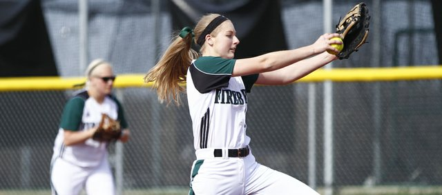 Free State pitcher Meredith Morris goes into her delivery during the third inning against Shawnee Mission West on Thursday, April 25, 2013, at Free State High School.