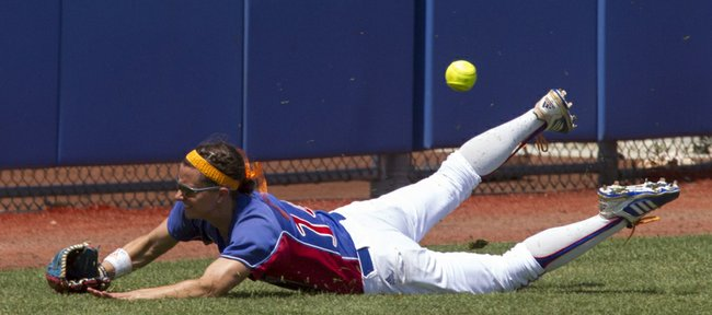 Kansas' Maggie Hull is unable to come up with the ball after diving for it in foul territory during Kansas' game against Baylor Sunday afternoon at Arrocha Ballpark.