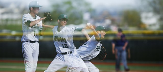 In a multiple-exposure image, Free State pitcher Dane McCullough goes into his delivery during the fifth inning on Monday, April 29, 2013 at Free State High School. Nick Krug/Journal-World Photo