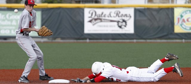Lawrence High's Shane Willoughby, right, slides into second base safely on a steal in a game against Shawnee Mission North on Wednesday, May 1, 2013, at LHS.