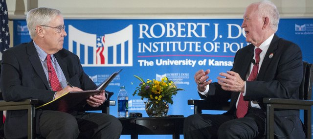 Dole Institute director Bill Lacy, left, interviews Retired Brig. Gen. Carl Reddel  at the Dole Institute of Politics Thursday evening during one of the presentations that are part of the 2013 Dole Lecture Series. Reddel spoke about Dwight Eisenhower's legacy.