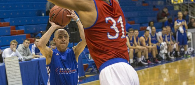 Former Kansas player Wayne Simien towers over Richard Rosenzweig, New York City, as he goes for a block during a game at the Bill Self Fantasy Camp on Thursday, May 2, 2013, at Allen Fieldhouse.