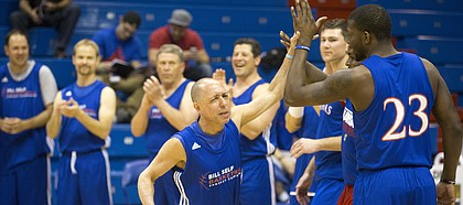 Richard Rosenzweig slaps hands with former Kansas player Mario Little as he is introduced before a game at the Bill Self Fantasy Camp on Thursday, May 2, 2013, at Allen Fieldhouse.
