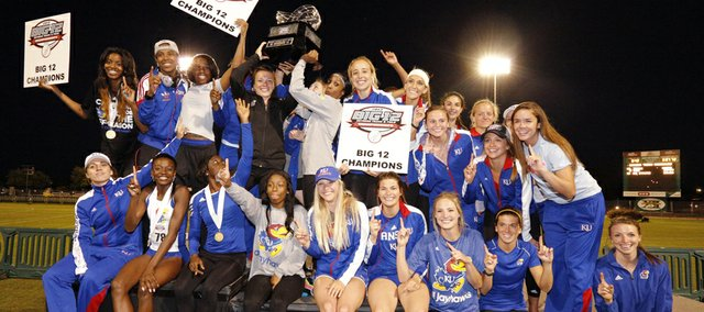 Members of Kansas University's women's track and field team celebrate the school's first Big 12 Outdoor title on Sunday, May 5, 2013, in Waco, Texas.