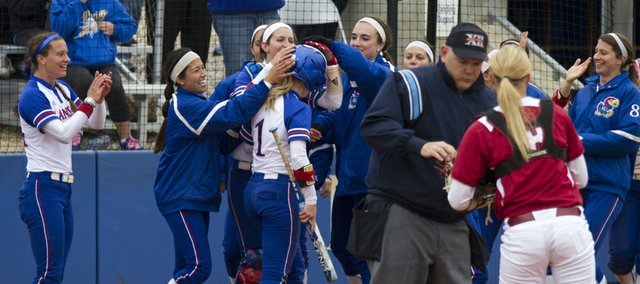 Kansas' Cassen Salamone (1) is congratulated by teammates after scoring during Kansas' senior day game against Oklahoma Sunday, May 5, 2013, at Arrocha Ballpark.