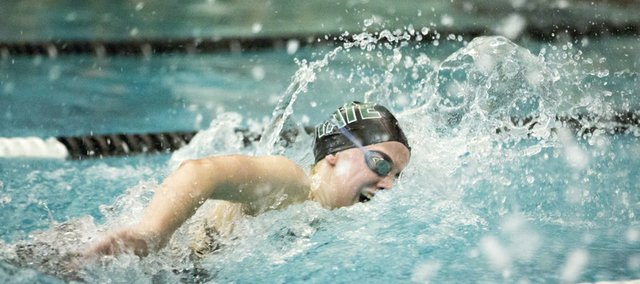Free State sophomore Eliza Anderson competes in the finals of the 200 freestyle relay at the Sunflower League Championships held Saturday, May 4, 2013, in Olathe.