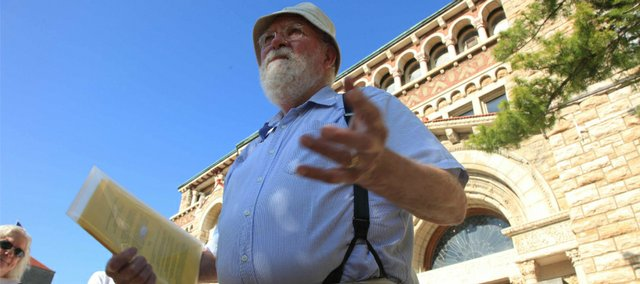 Kansas University Professor Emeritus Ted Johnson prepares to lead his Stop Day walking tour of the KU campus in May 2012.