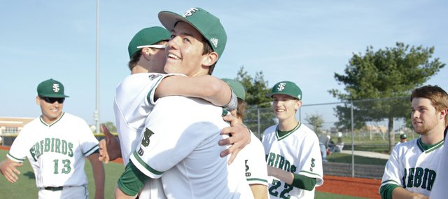 Free State pitcher Dane McCullough gets a hug from teammate Jacob Caldwell following the Firebirds' win over Lawrence High on Monday, May 6, 2013 at Free State High School. McCullough gave up five hits in a 5-0 shutout. Nick Krug/Journal-World Photo