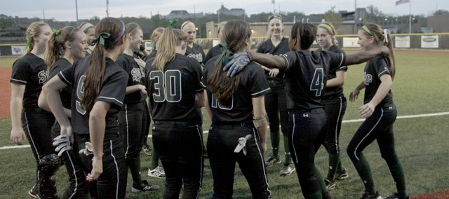 A'Liyah Rogers (4) right, gathers to celebrate with the Free State Firebird team after their 7-4 win of the Lawrence Lions at LHS Wednesday night. .