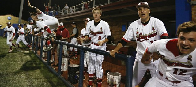 The Lawrence High bench clears onto the field as the winning run for the Lions is walked in during the tenth inning against Free State on Thursday, May 9, 2013 at Hoglund Ballpark. Nick Krug/Journal-World Photo