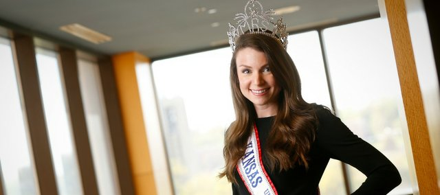 Mrs. Kansas United States 2013, Lawrence resident Rachel Karwas, is pictured Wednesday at the Kansas Union at Kansas University. She is preparing for nationals and working with charities to raise awareness and funds to fight children's cancer. She is the second Mrs. Kansas from Lawrence this year.