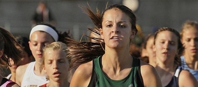 Free State's Bailey Sullivan runs in the second heat of the 1,600 at the Sunflower League track and field championships on Friday, May 10, 2013, at Shawnee Mission North.