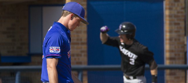 Kansas' Jordan Piche' walks back to the mound as Kansas State's Austin Fisher (3) rounds third base after hitting a two run home run to give KSU the lead in the ninth inning during Kansas' game against Kansas State, Saturday at Hoglund Ballpark.