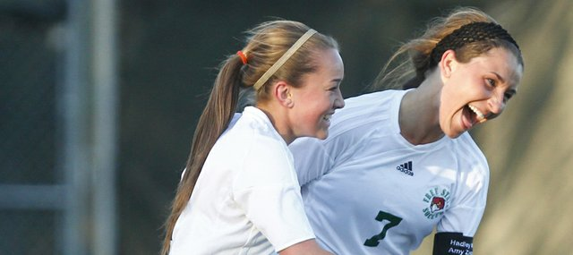 Free State forward Maddie Dieker (7) celebrates with forward Tori Karlin after Dieker's second-half goal against Olathe Northwest on Tuesday, May 14, 2013 at Free State High School. Nick Krug/Journal-World Photo