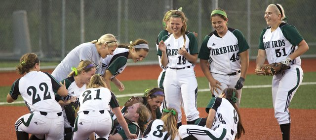 Free State players celebrate their victory over Olathe Northwest in the 2013 softball regional championship game, Wednesday at FSHS. With the win, the Firebirds advance to the state tournament.