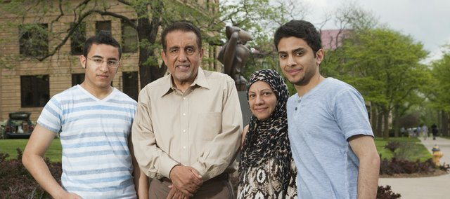 Salam Al Ghafli and his mother Fatimah will both graduate from KU on Sunday with bachelor&#39;s degrees. Salam and Fatimah took six classes together, and at Fatimah&#39;s insistence, sat side by side in the front row. Gathered Thursday in front of Strong Hall from left are Salam&#39;s brother Hassan Al Ghafli, his father Mansour Al Ghafli, his mother Fatimah Al Ghafli and Salam.