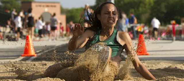 Free State junior Alexa Harmon-Thomas lands in the sand pit while competing in the girls long jump at the Kansas class 6A state regional track meet Friday at Lawrence High.