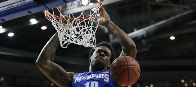 Memphis forward Tarik Black dunks against Michigan State forward Adreian Payne (5) in the second half of a third-round game of the NCAA college basketball tournament Saturday, March 23, 2013, in Auburn Hills, Mich.