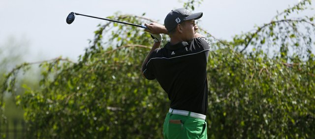 Free State's Alex Green watches his drive from the tee box on the first hole during the 6A state golf tournament on Monday, May 20, 2013 at Meadowbrook Golf and Country Club in Prairie Village.