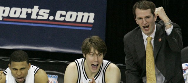 From left, Vanderbilt's Shan Foster, Dan Cage, Alex Gordon, Ted Skuchas and assistant coach Brad Frederick cheer from the bench in the closing moments of their game against George Washington University during the first round of the NCAA East Regional basketball tournament at Arco Arena in Sacramento, Calif., Thursday, March 15, 2007. Vanderbilt won the game, 77-44.