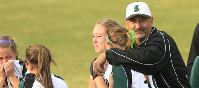 Free State softball coach Lee Ice, center, comforts Courtney Parker (25) and Kaley Delg (19) after a 3-2, eight-inning loss to Derby in the first round of the Class 6A state softball tournament Thursday, May 23, 2013, in Overland Park.