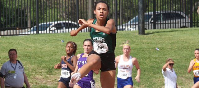 Free State junior Alexa Harmon-Thomas distances herself from the pack during a first-place finish in the girls 300-meter hurdles, Saturday at the Class 6A state track and field meet at Cessna Stadium in Wichita. Harmon-Thomas' mark of 42.70 seconds tied the meet record as the Firebirds' girls also took home state-champion honors as a team.