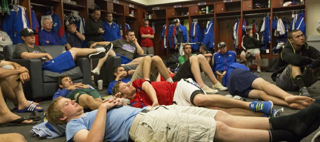 Members of the Kansas University baseball team watch the NCAA tournament selection show Monday, May 27, 2013, in the clubhouse at Hoglund Ballpark. The Jayhawks missed out on a tourney berth, despite a runner-up finish at the Big 12 tournament.