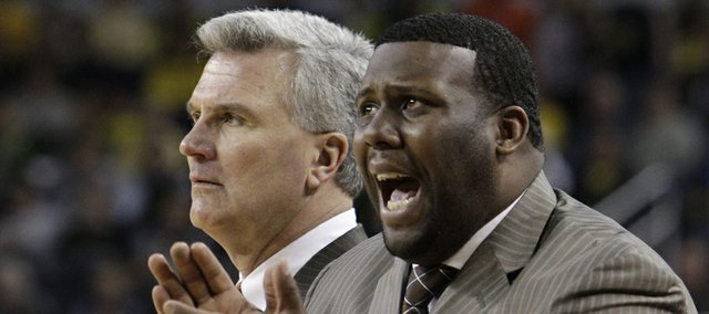 Illinois head coach Bruce Weber, left, and assistant coach Jerrance Howard watch from the sidlines during the second half of a game against Michigan in this 2012 Associated Press file photo. Though nothing is official, Howard is likely to replace Kansas University assistant coach Joe Dooley, KU coach Bill Self confirmed Wednesday.