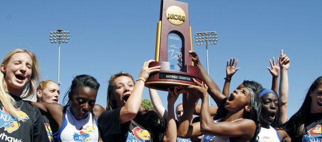 Kansas University's women's track team celebrates after winning the NCAA Outdoor track and field championships on Saturday in Eugene, Ore.