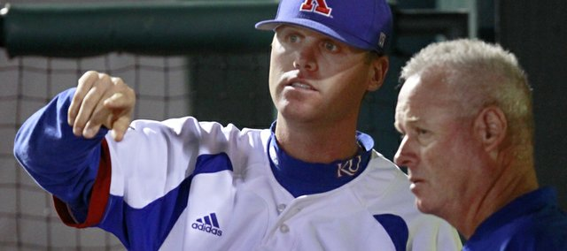 Kansas University assistant baseball coach Ritchie Price, left, talks with KU head coach Ritch Price, his father, during the Jayhawks' victory over Oklahoma State on May 24, 2013, at the Big 12 Championship in Oklahoma City.