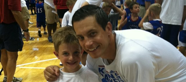 Ryan Robertson, right, poses with his son J.D. at the Bill Self Parent/Child camp on Friday at Allen Fieldhouse.