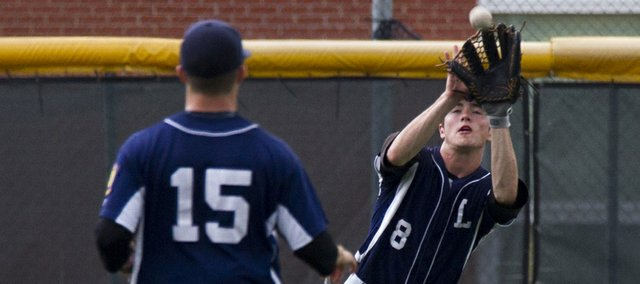 Lawrence Raiders' Adam Rea (8) makes a play on a fly ball while teammate Shane Willoughby (15) watches during the first game of the Raiders' double header against Natural Baseball Academy, Saturday, June 15, 2013, at Lawrence High.