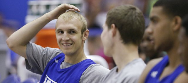 Kansas guard Conner Frankamp smiles while talking with teammate Tyler Self on the bench prior to a scrimmage on Wednesday, June 12, 2013, at the Horejsi Center.