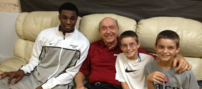 Future Kansas University basketball player Andrew Wiggins, left, visits with ESPN's Dick Vitale and Vitale's twin grandsons, Jake and Connor Krug, after one of Wiggins' high school games with Huntington (W.Va.) Prep.