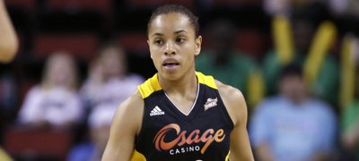 "Tulsa Shock rookie guard Angel Goodrich brings the ball upcourt against the Seattle Storm in a preseason WNBA game, May 17, 2013, in Seattle. Goodrich, a former Kansas University player, says she's ""starting to get into the flow of things,"" 10 games into her pro career."