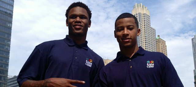 Ben McLemore and Michigan's Trey Burke pose for a photo at the 9/11 Memorial in New York City. Several members of the 2013 NBA Draft class toured the grounds Wednesday and interacted with family members of several victims of the terrorist attacks from Sept. 11, 2001. Photo by Matt Tait.